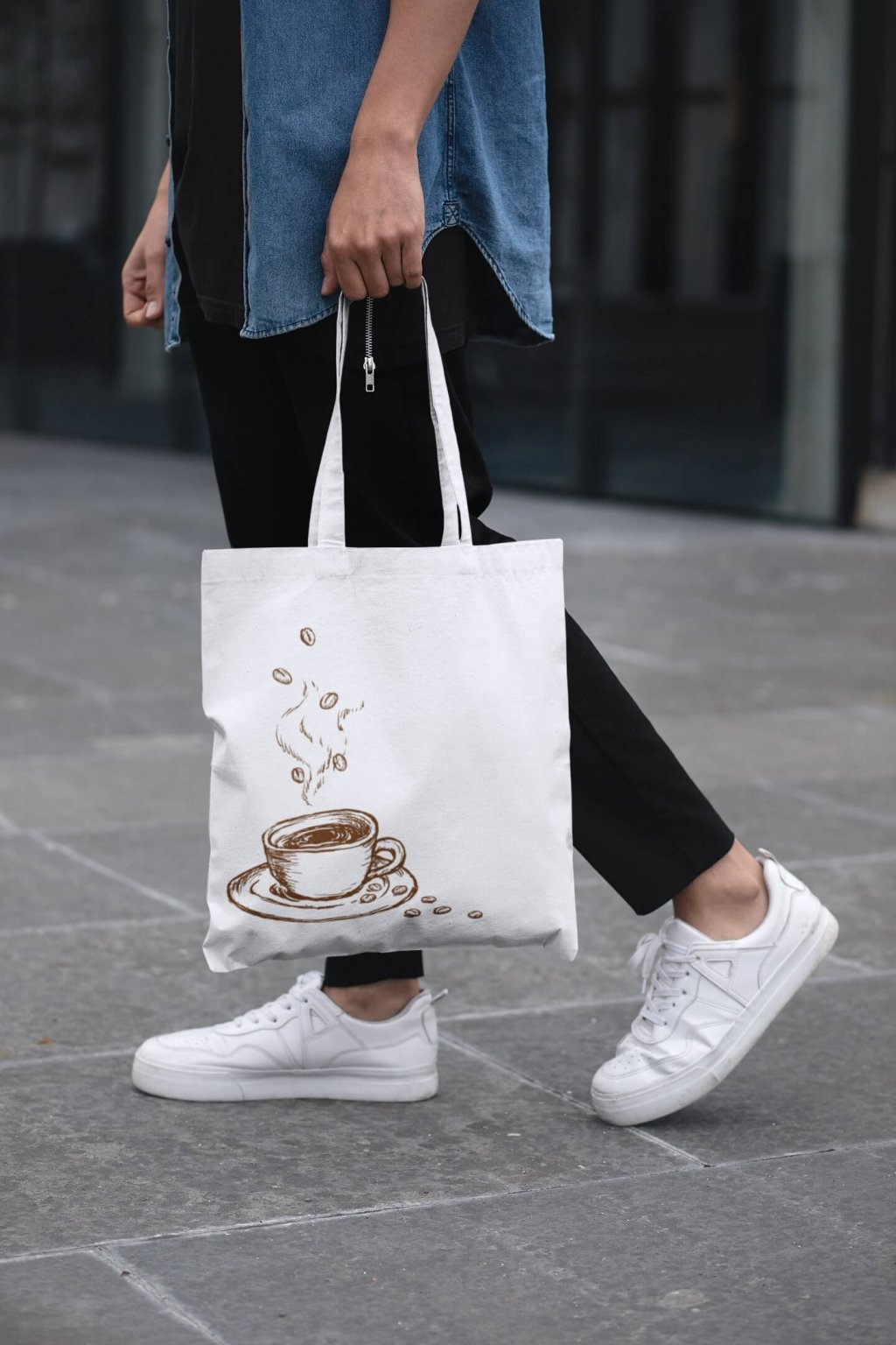 cropped face mockup of a man holding a tote bag in the street 29424 (2)