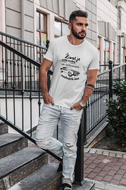 t shirt mockup of a serious looking man standing on concrete steps 1023 el