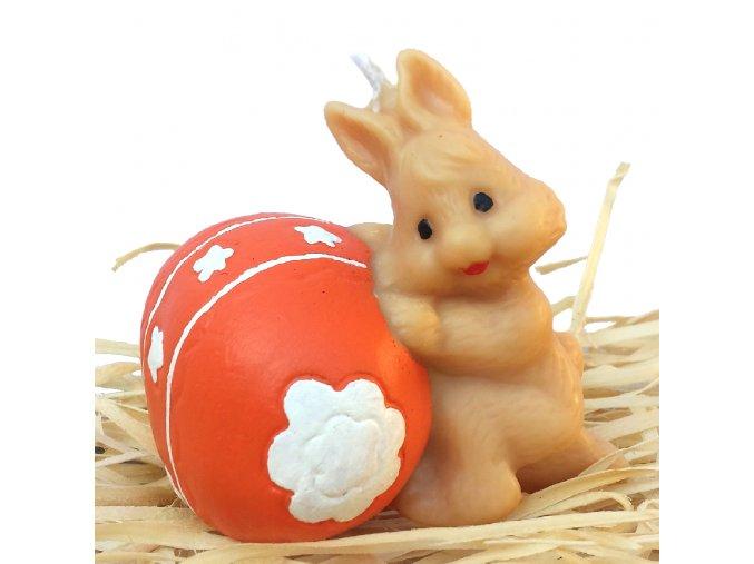 Ručně malovaná svíčka - zajíček kutálející vajíčko 7 cm oranžové