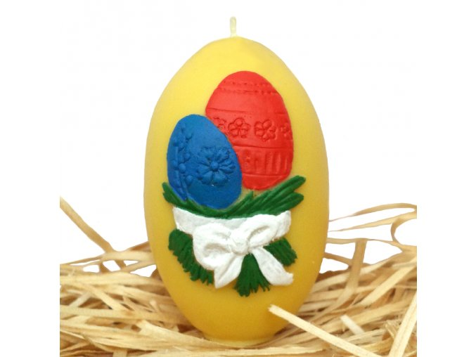 Ručně malovaná svíčka s reliéfem - velikonoční vajíčka s mašličkou žluté 8.5 cm