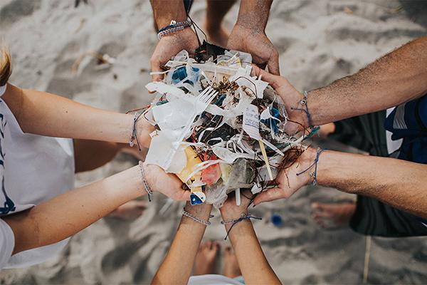 4ocean_hands-holding_trash
