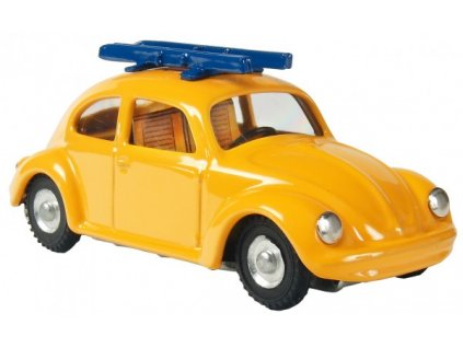 Auto VW brouk s lyžemi žluté