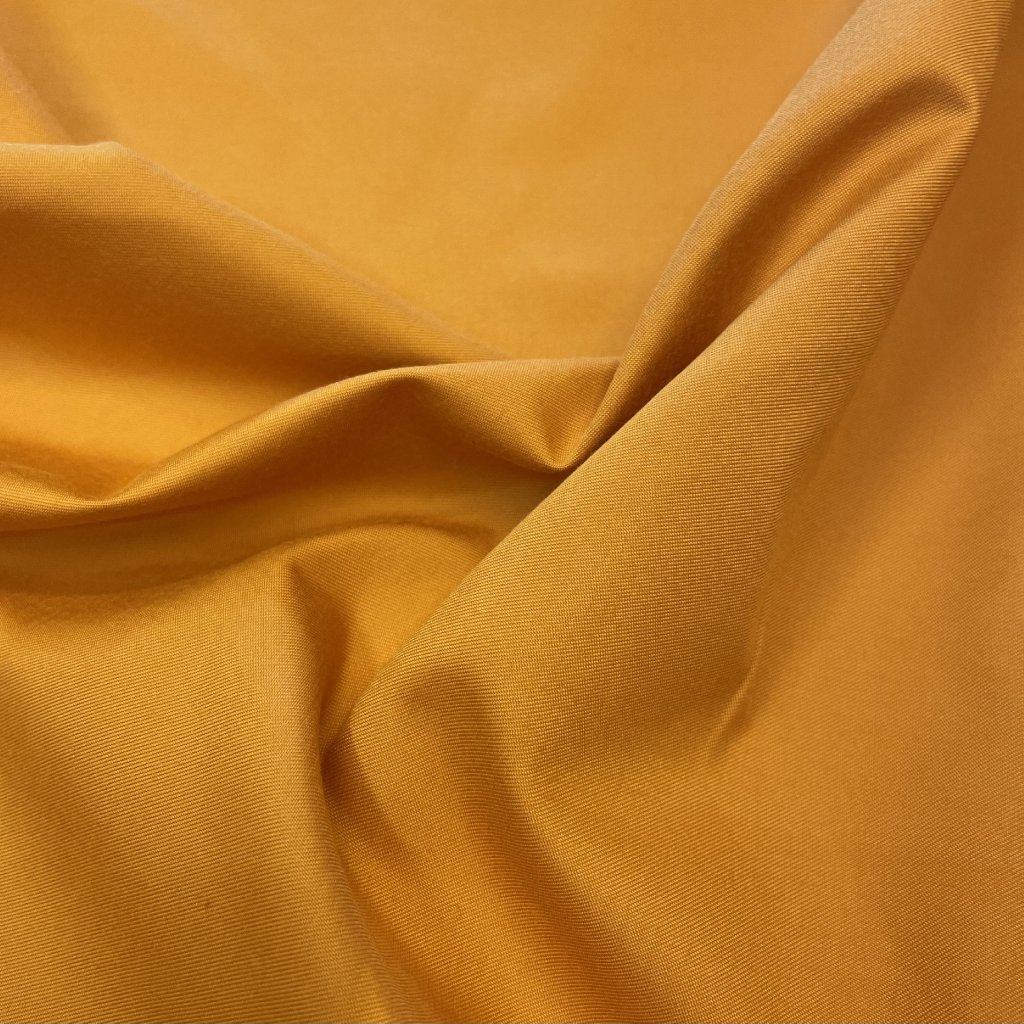 Pomerančový jemný šusťák/pevnější podšívkovina