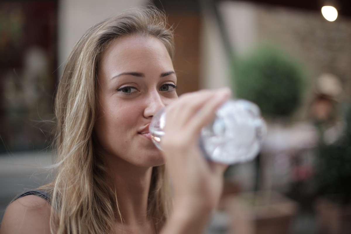 selective-focus-photo-of-smiling-woman-drinking-water-from-a-3763929