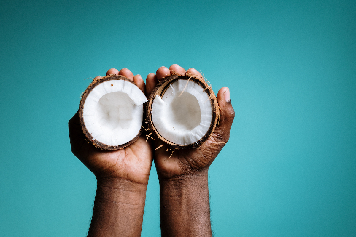 photo-of-person-holding-coconut-4631069