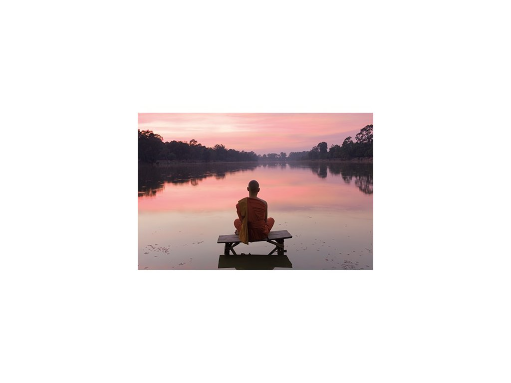 budhist monk at sunset