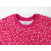 Dětské růžové pyžamo se srdíčky detail krku