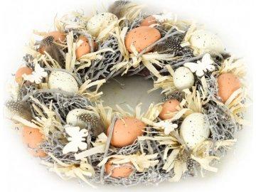 Věnec s proutím, umělými vajíčky  a peřím, velikonoční dekorace