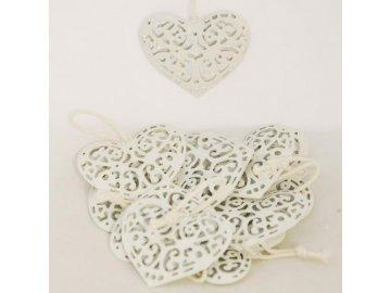 Bílé vyřezávané srdce z kovu