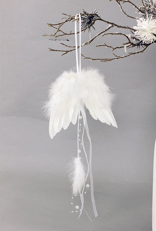 Andělská křídla z peří,, barva bílá, baleno 6 ks v polybag. Cena za 1 ks.