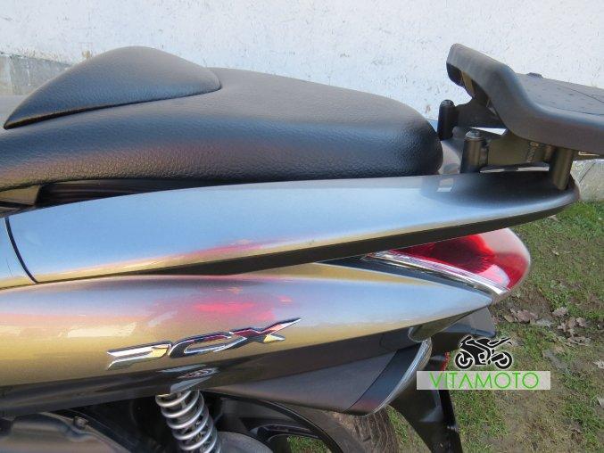 Honda PCX 125 - madlo horní část
