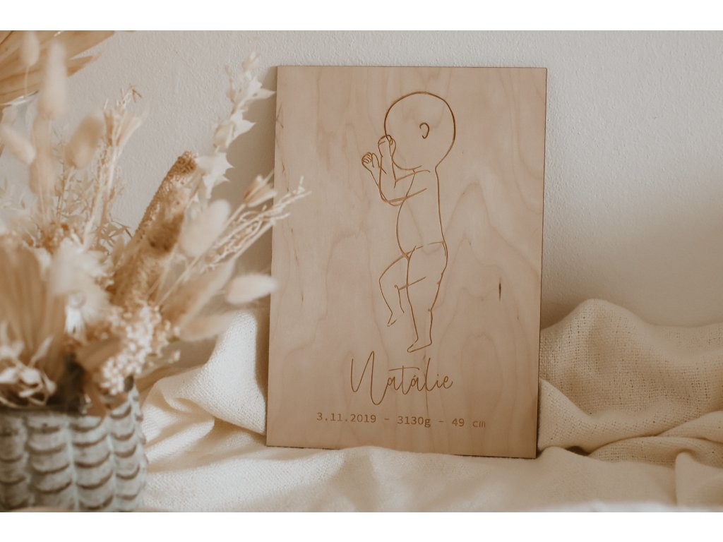 Dřevěný minimalistický obraz miminka