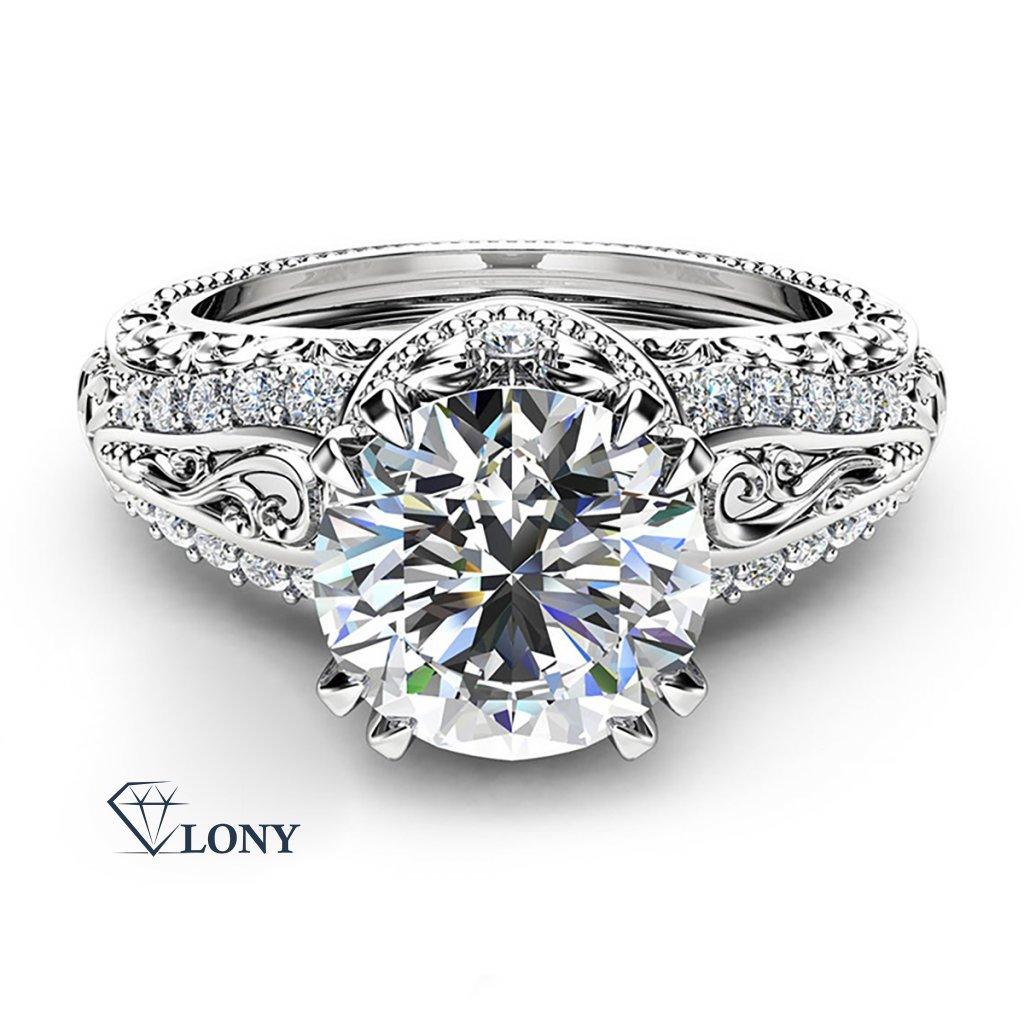 Luxusní prsten z bílého zlata s briliantem