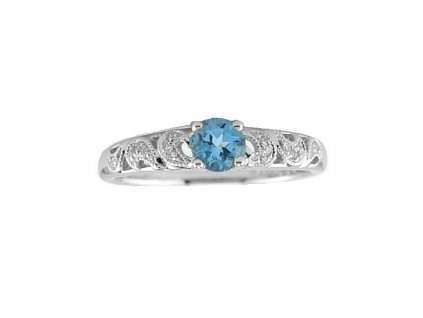 Lesklý topazový prsten z bílého zlata zdobený brilianty