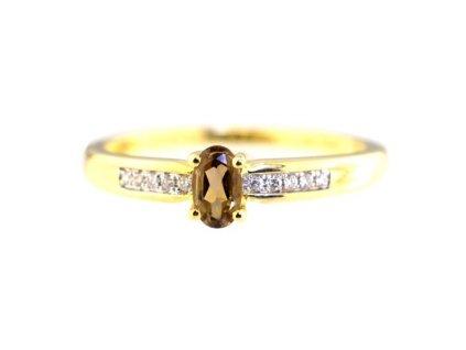 Záhnědový prsten ze zlata s páskem briliantů