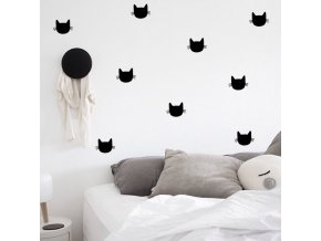 postel s kočičkama